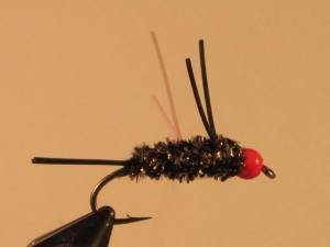 A Carpetbagger style nymph with brown body and orange bead. Very good fly.