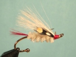 The Alaska Mary Ann fly pin is of a classic fly first tied in the 1920s by Frank Dufresne. The color scheme for the fly he derived from the red and white carved-ivory ice-fishing decoys that the native Eskimos made.