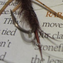 Attach the tippet to the bottom fly to the bend of the hook of the larger, stonefly. Use a Uni Knot or Duncan Loop.