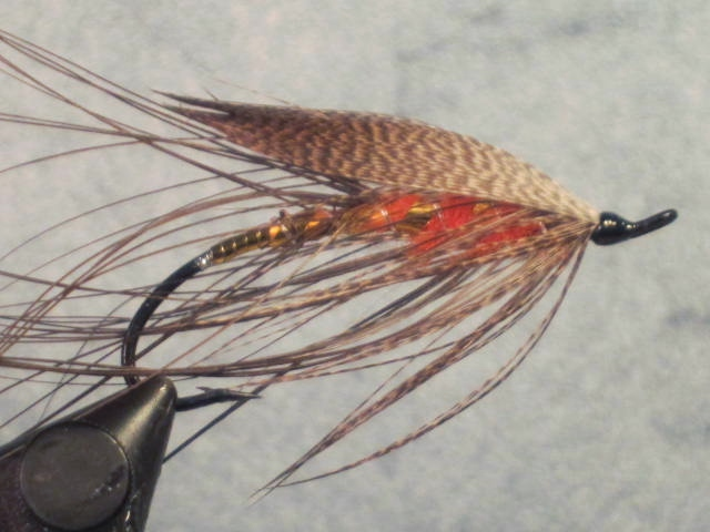 A John Shewey original pattern, the Autumn Bronze is a classic-style steelhead Spey fly.