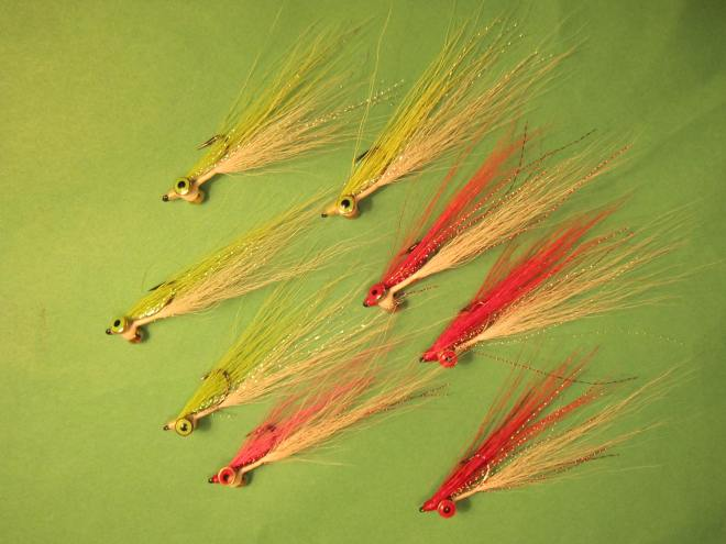 Completed Clouser Minnows with chartreuse, red and pink bucktail wings.